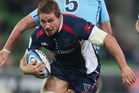 Scott Fuglistaller of the Rebels is tackled during the round 15 Super Rugby match between the Rebels and the Waratahs at AAMI Park. Photo / Getty Images.