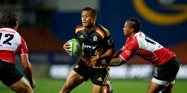 Tim Nanai-Williams of the Chiefs is tackled by Stefan Watermeyer (L) and Elton Jantjies (R) of the Lions during the round 12 Super Rugby match between the Chiefs and the Lions. Photo / Getty Images.