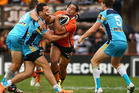 Martin Taupau of the Tigers is tackled during the round 8 NRL match between the Wests Tigers and the Gold Coast Titans at Leichhardt Oval. Photo / Getty Images.