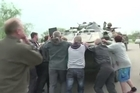 Yasnogirka locals near Slavyansk in eastern Ukraine Friday attempted to stand up to Ukrainian soldiers in armoured vehicles entering their town.