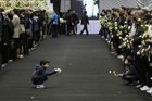 Children wait to pay tribute to the victims of Sewol at a group memorial altar in Ansan. Photo / AP