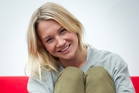 Television presenter Hayley Holt takes her shoes off in preparation for going barefoot to work today. Photo / Sarah Ivey