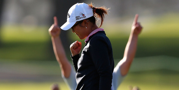 Lydia Ko celebrates after winning her second tournament as a professional. Photo / Getty Images