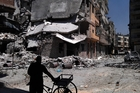 The city of Homs has suffered enormous damage from the fighting. Photo / AP