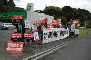Striking petrol tanker drivers and supporters hold a picket outside Riverside BP Connect. Photo / Lindy Laird