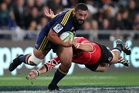 Ma'afu Fia of the Highlanders bursts through the Lions defence last night. Photo / Getty Images