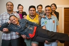 Rose Toki with six of her 10 children, Michael, 33, Dina, 23, Anam, 25, Tavai, 18, Allan, 15, and Megan, 14. Mrs Toki graduated and now works in early childhood learning. Photo / Greg Bowker