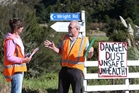 Alex Wright, of the Pipiwai Titoki Road Action Group, with Whangarei District road engineer Mike Batchelor. Photo / Michael Cunningham