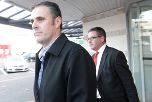 Adam Dunnett (left), outside Napier Courthouse, with lawyer Jonathan Krebs. Photo / HBT