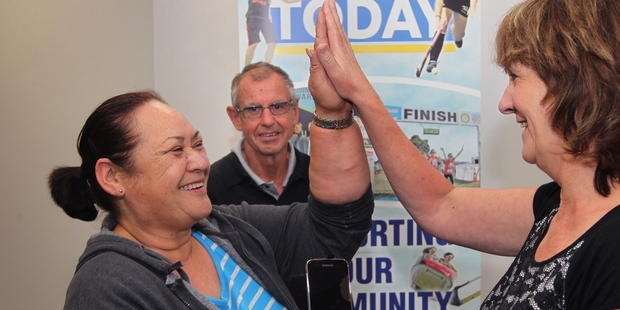 YEEEEEEESSSS! The winner of the Vodafone Galaxy 5 Ivy Graham high-fives Hawke's Bay Today assistant editor Linda Hall, while John Graham watches. PHOTO/DUNCAN BROWN HBT141591-03