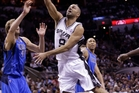 Tony Parker of the Spurs shoots over the Mavericks' Dirk Nowitzki during the first half of their game-seven clash. Photo / AP