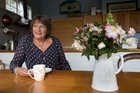 Lauraine Jacobs at home in her 'rambly' but surprisingly good kitchen. Photo / Richard Robinson