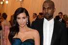 Kim Kardashian, left, and Kanye West both wear Lanvin. Photo / AP