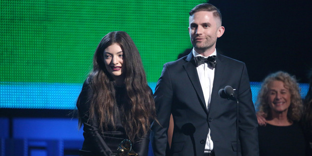 Lorde, left, and Joel Little accept the award for song of the year for Royals at the Grammy Awards.