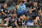 Nick Phipps of the Waratahs breaks through a tackle during the round 12 Super Rugby match between the Waratahs and the Hurricanes. Photo / Getty Images.