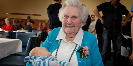 May Donald, who turned 100, with her newest great-great-grandchild, 3-week-old Baxter Cowley. Photo/Bevan Conley