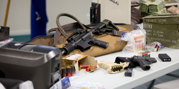 Items seized during Operation Genoa where more than $3 million in assets including a Ferrari, Porsche and Maserati were seized during police searches. Photo / Richard Robinson