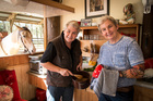 Lynda, left, and Jools - with a temporary sailor tattoo - in the kitchen with best mate Stanley. Photo / Michael Craig
