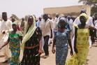 Four female students who were abducted by gunmen are reunited with their families in Chibok, Nigeria. Photo / AP