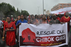 Women attend a demonstration calling on the government to rescue the kidnapped schoolgirls. Photo / AP