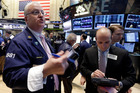 Trader Thomas Ferrigno, left, works on the floor of the New York Stock Exchange. File photo / AP