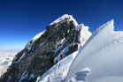 Climbers navigate the knife-edge ridge just below the Hillary Step on their way to the summit of Mount Everest. Photo / AP