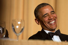 President Barack Obama laughs as actor and comedian Joel McHale speaks during the White House Correspondents' Association (WHCA) Dinner. Photo / AP