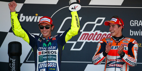 Valentino Rossi of Italy, left, celebrates his second position next to Marc Marquez of Spain, on the podium of the Spainish Motorcycle Grand Prix. Photo / AP