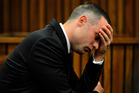 Oscar Pistorius, cradles his head in his hands during court proceedings in Pretoria, South Africa. Photo / AP