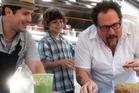John Leguizamo, Emjay Anthony and Jon Favreau in a scene from Chef. Photo / AP