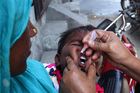 A Pakistani health worker gives a child a polio vaccine in Lahore, Pakistan. Photo / AP