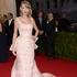 Taylor Swift wears a pink gown by Oscar de la Renta. Picture / AP Images