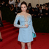 Actress Elizabeth Olsen, or an ice skater? The dress is by Miu Miu. Picture / AP Images