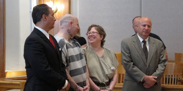 Jeremy Moody, left, talks to his wife, Christine Moody, right, while standing with their lawyers. Photo / AP