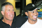 Steve Williams (left) with Tiger Woods. Photo / NZPA