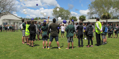 Balloons filled with helium were set free at Katikati College as a tribute to 16-year-old Ricky Pettigrew shortly after his death.