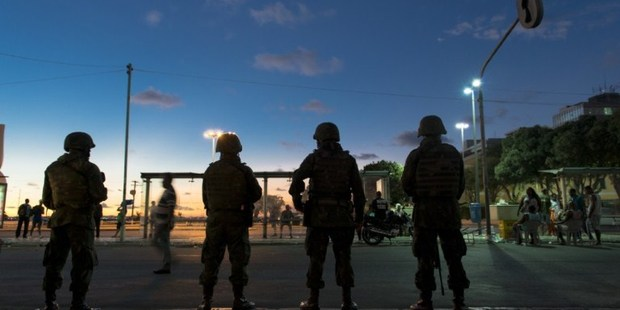 Brazilian troops stand guard after being deployed to maintain security after police declared a strike in Salvador, northeast of Brazil. Photo / AP