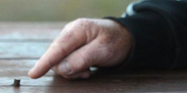 Mosgiel man John Elliott points to the bullet he found in his hardwood deck. Photos / Peter McIntosh.