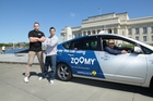 Zoomy co-founders Neil MacDonald (left) and James Fisk with a Zoomy driver.