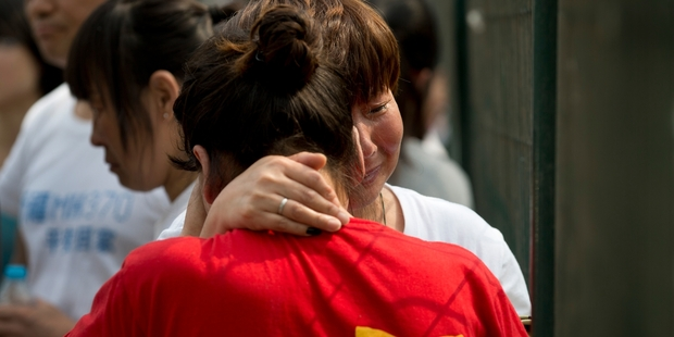 Relatives of those on the missing plane have had no comfort after searches have so far failed to come up with a single piece of debris. Photo / AP