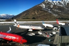 Queenstown Airport's mountain-surrounded runway will be widened and an improved lighting system installed to allow night flights.