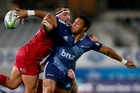 Blues back George Moala offloads against the Reds at eden park on friday night. Photo / Getty Images