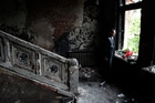 A man lays flowers inside the burned trade union building in Odessa where at least 32 people lost their lives. Photo / AP