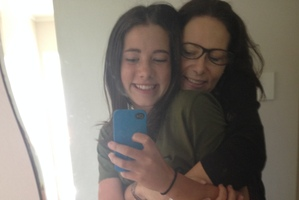 Janetta Mackay and her 13-year-old daughter snap selfies.