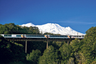 Snow-capped mountains form the perfect backdrop as the Northern Explorer travels near National Park.