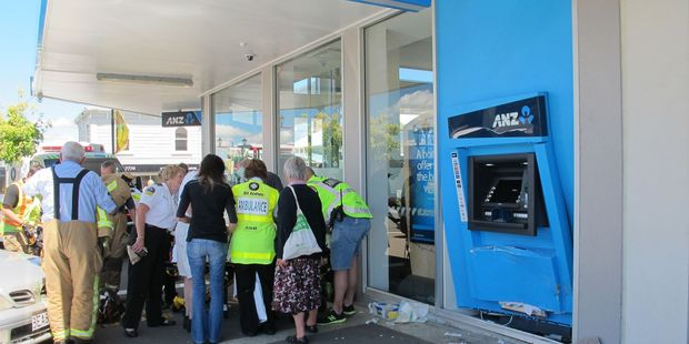 A Waihi woman who was hit by a car at the ANZ ATM machine is loaded onto a stretcher before being flown to Waikato Hospital on Friday morning.