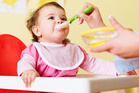 Babies who are spoon-fed are more likely to be overweight as toddlers than those who feed themselves. Photo / Thinkstock