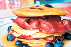Buttermilk pancakes are served with bananas, grilled bacon and blueberries. Photo / Doug Sherring