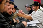 Customers check out different strains of marijuana at a retail store which opened in Colorado last week. Photo / AP