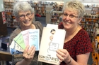 POPULAR: Chris Hawker (left), Masterton District Library customer services librarian, and Sandy Green, manager, with The Luminaries, the most reserved book of 2013. PHOTO/LYNDA FERINGA